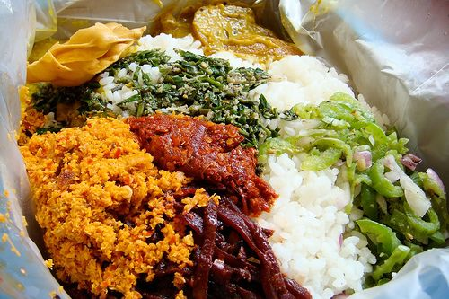 Sri Lankan lunch box... curry and rice with condiments