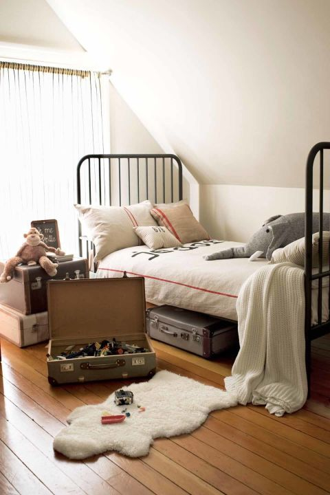 This San Francisco bedroom involves loads of antique charm. Genius idea: The old-fashioned suitcases double as a great storage space for toys!