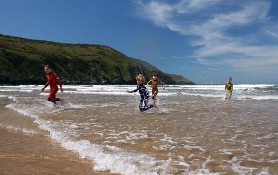 Family beach fun with Saltskin wetsuits