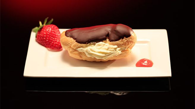 Chocolate Éclair with Strawberries and Cream