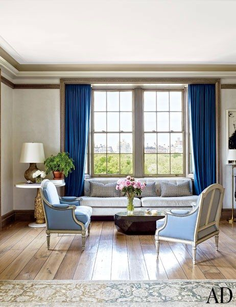 A pair of antique armchairs upholstered in a Clarence House fabric face an Arik Levy low table in the light-filled living room   archdigest.com