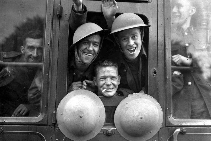 British troops cheerfully board their train for the first stage of their trip to the western front, somewhere in England, om September 20, 1939.
