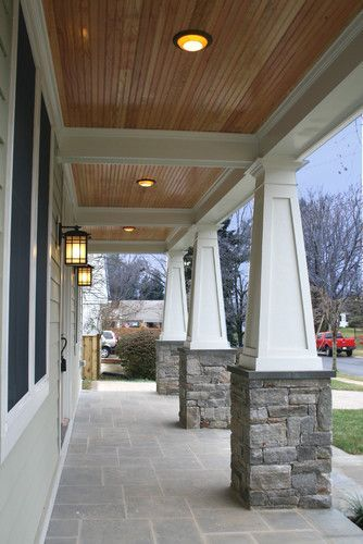 Craftsman tapered columns with stone cornices no railing bluestone porch green siding