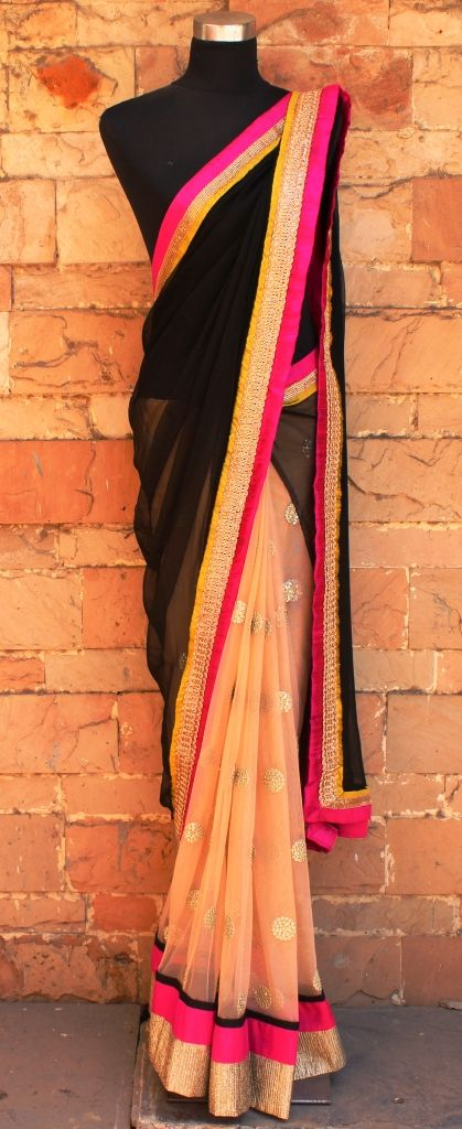 Saree designed by Priti Sahni Saree in Light Peach net pleats with dull gold sequined butti and black chiffon pallu. The border is of dull gold zardozi handwork and fuchsia/ olive accent To get more details, please write to preti.designs@gmail.com