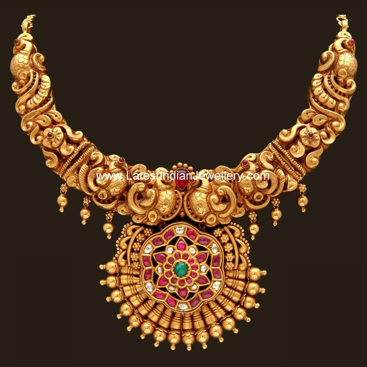 Grand Nagas Work Gold Necklace and attractive wedding bridal jewellery look...