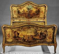 A Venetian paint decorated bedstead, 19th century, serpentine head and footboard extensively painted with scrolls and floral sprays enclosing vignettes of ruins, straight rails.