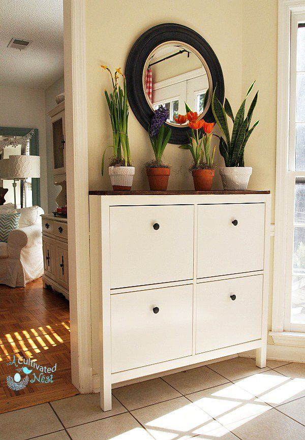 Ikea Hemnes is a great piece if you need something narrow. Fits flush to the wall over molding! It's a shoe cabinet but can be used for so much more.