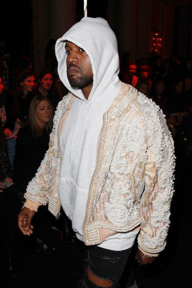 Kanye West wearing  Adidas Yeezy Boost  750, Balmain Custom Embroidered Bomber Jacket designed by Olivier Rousteing, Saint Laurent Custom Destroyed Skinny Jeans