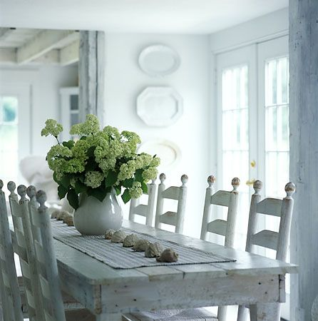 love. love. love. i so want a farmhouse table. and look at those chairs! just gorgeous.