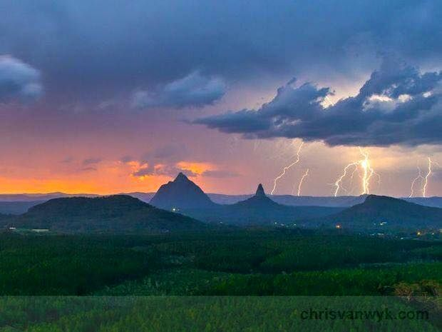 What an amazing photo… Glass House Mountains, Queensland, sunset storm!  Image credit: Chris Van Wyk