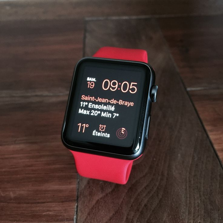 Space grey Apple Watch with red band