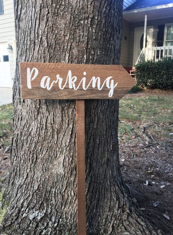This wooden parking sign is perfect for any rustic venue. Are you looking for a sign to point guests to the parking area at your wedding? Do you need rustic signage for your resort or campground? This sign is very versatile and can be used in a variety of different settings.   OVERVIEW  ❧ This sign features the word Parking painted in white acrylic paint in the font of your choice.  ❧ Painted on a piece of barn wood that is approximately 20 X 5 mounted to a 3 stake  ❧Each of my items are…