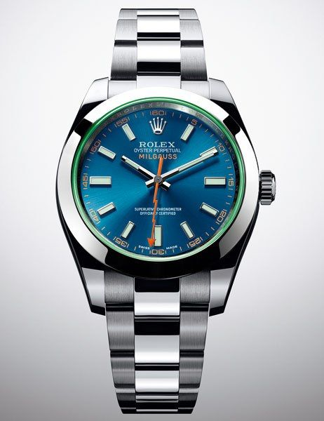 ROLEX Oyster Perpetual Milgauss (Men) • The playfully polychromatic Oyster Perpetual Milgauss is named for its ability to withstand strong magnetic interference of up to 1,000 gauss units. The innovative timepiece features a blue dial encircled by a scratch-resistant green sapphire crystal, and a brilliant orange seconds hand shaped like a lightning bolt. Hands and hour markers of 18K white-gold ramp up the luxe factor.