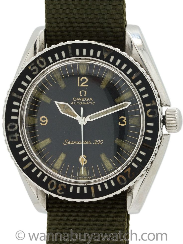 Omega Seamaster 300 ref 165.024 circa 1968 (photo) - Omega Stainless Steel Seamaster 300 ref 165.024 SC movement serial# 25.6 million circa 1967. 42 x 47mm bombe lug case with screw down back with Seamonster logo, with original bi-directional rotating bakelite elapsed time bezel. Original matte black with patina'd luminous indexes and wide Kite shaped luminous hands. Powered by 24 jewel calibre 552 self winding movement with sweep seconds and with signed Omega crown. This vintage Seamster…