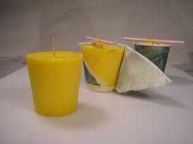 How to make an Easy Votive Candle.  Same process for a pillar candle except must wax & a mold suitable for a pillar candle.    http://www.naturesgardencandles.com/ - great for candle making equipment and fragrance oils (in coffee, fresh cut roses, etc)    http://www.candlescience.com/fragrance/  - great for fragrances, cheaper candle making equipment and color chips in pale pink, turqoise and violet.