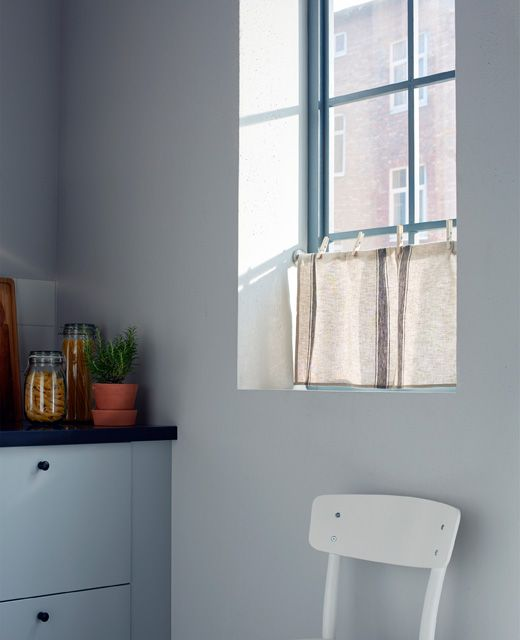 Want some privacy without blocking all the light? Hang a tea towel from a curtain wire in the kitchen window and clip it with clothes pegs | #IKEAIDEAS #kitchendecor