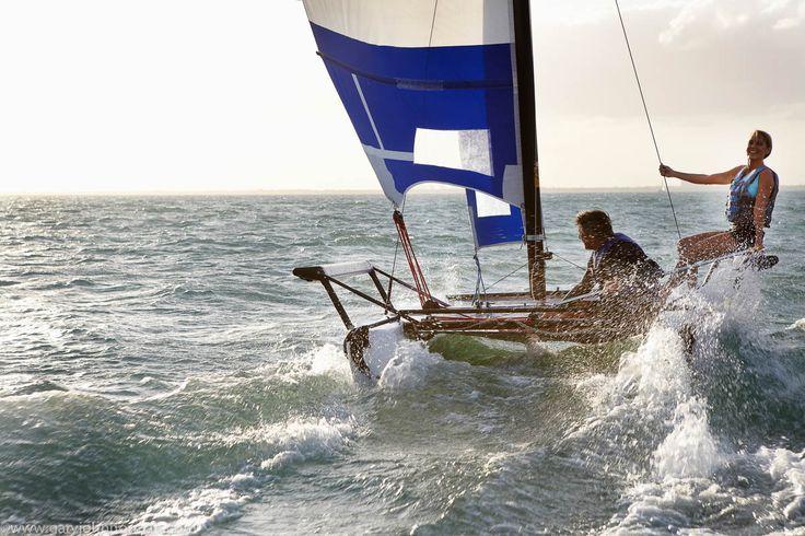 Man and woman sailing a Hobie catamaran boat in poor sailing conditions