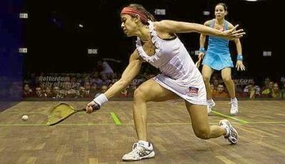 Nicol David professional women's squash player in an Adidas Stella McCartney tennis/squash dress.