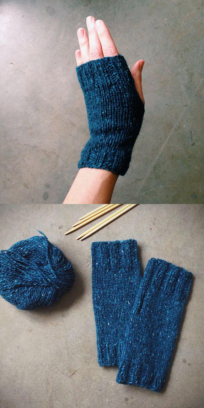 Five Mittens On Knitting Needles