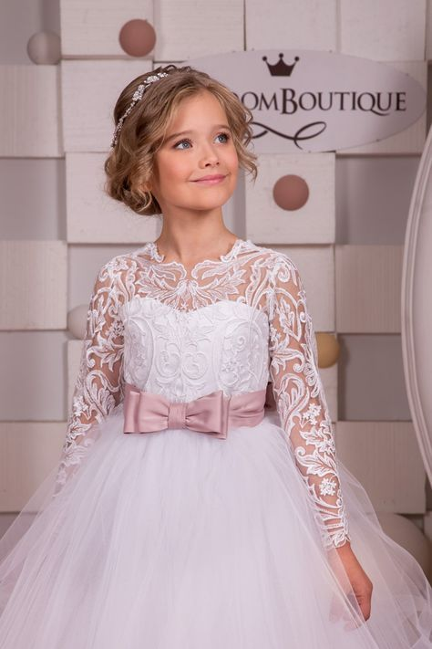 Please read our store policies before placing your order here https://www.etsy.com/ru/shop/Butterflydressua/policy  Gorgeous white flower girl dress with multilayered skirt, lace corset with long lace sleeves, buttons, zipper and satin stripe with bow.  Item material: upper layer of the skirt- tulle middle layer of the skirt- tulle  lower layer of the skirt- taffeta  corset- lace, satin  Dress color: ivory  white  Color of the sash: ivory  blush pink  red  ice blue  royal blue  navy blue…