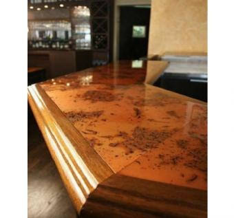 The Patina Copper Inlay Copper Bar Top Is Bordered By A Mahogany Ogee Rail.  This Copper Bar Top Can Be Seen At Spina Restaurant In NYC.