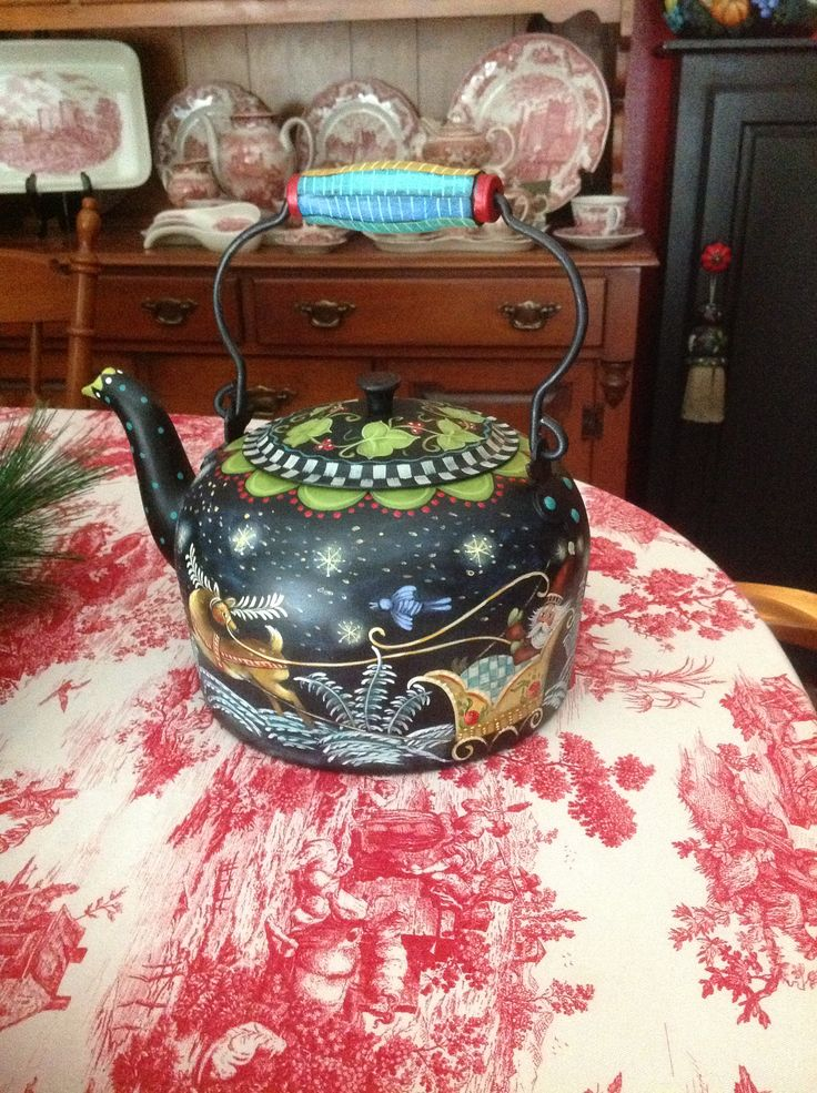Large metal kettle painted with a Jo Sonja design.
