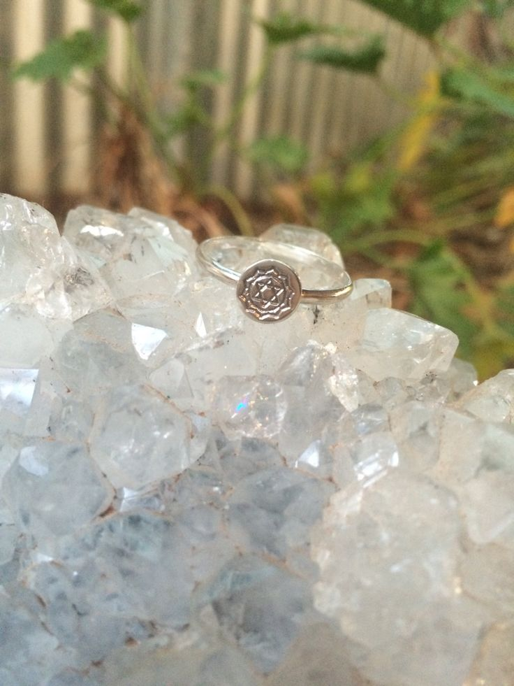 The heart chakra stacking ring This ring features the heart chakra symbol…