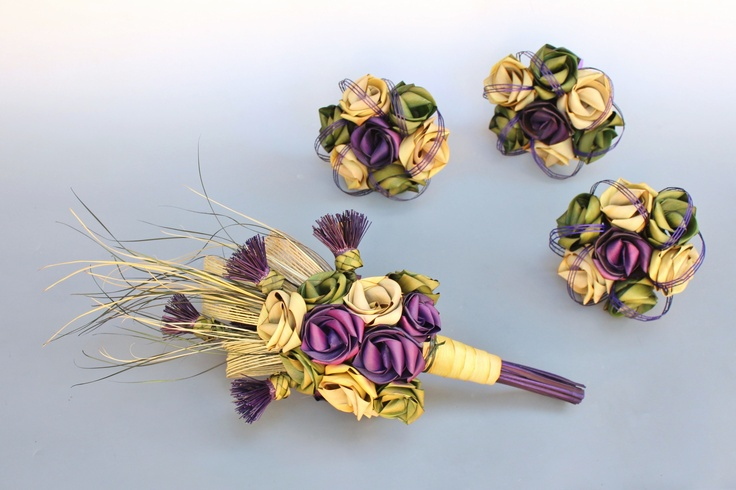 Thistle and rose cascading brides bouqet with seven flower bridesmaid posy bouquets.  www.flaxation.co.nz