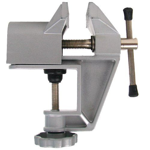 """60 Mm Fixed Aluminum Table Vice : (Toolusa)  This Little Table Vice Is So Small And Lightweight That You Can Toss It Into Your Toolbox And Take It Just About Anywhere. Great For Holding Pieces While Glue Dries, Or For Holding Objects While You Saw, Drill Or Solder, To Keep Both Of Your Hands Free While You Work. Approx. 5"""" Tall, And Weighs 14.8 Oz."""