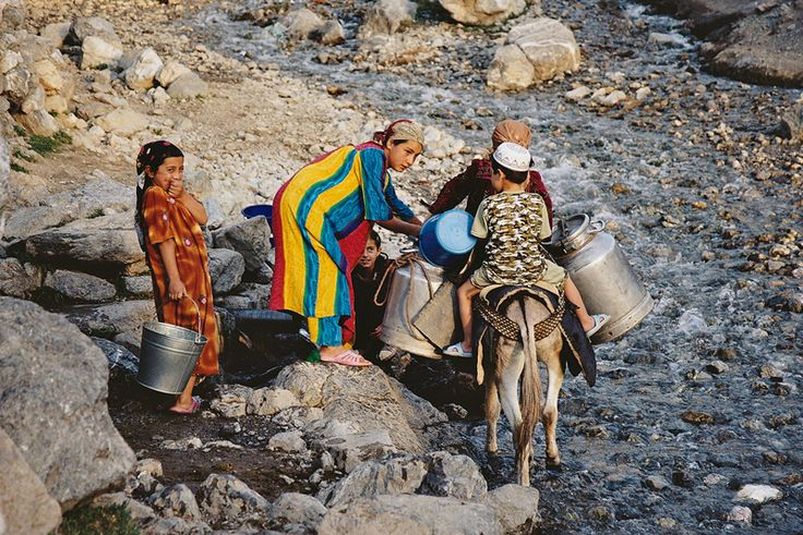Children gathering water in rural, mountainous Tajikistan