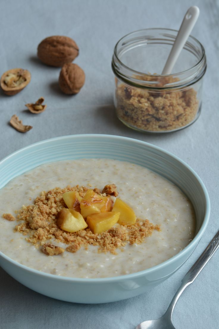 For a warming and healthy breakfast, top creamy oatmeal with maple-sweetened baked apple and crunchy quinoa and walnut crumbs.