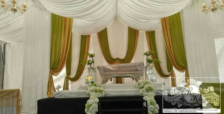 Pelamin doned under an a shaped tentage green gold white designed drapes R&K Wedding Essentials Facebook : https://m.facebook.com/rk.weddingessentials.7/ Instagram : rnk_weddingessentials Contact : 86133405 \ 90905607 #pelamin #decor #deko #kawin #sg #singapore #event #drapes #hydrangeas #floral #flow #rustic #voiddeck #mph #cc #RnKwe #dekorartist #pallets #wedding #theme #pastel #blink #stage #kerusi #meje #perkakas #dapur #rental #essentials