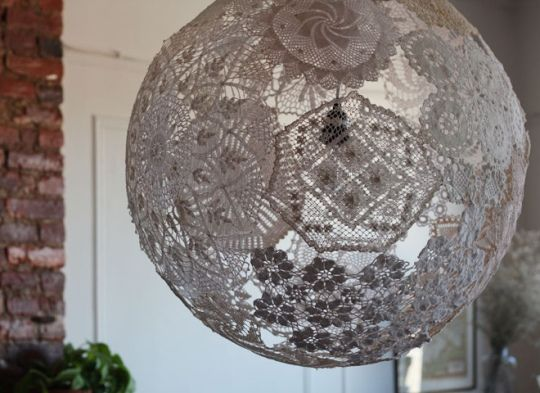 Doilies - a instant visual throwback to a much earlier age of home decor - get the modern pendant treatment in this handmade lamp by upcycling designer Shannon South. She used her collection of vintage crochet doilies to complete the project. The most beautiful part? The patterns it creates on the walls when lit