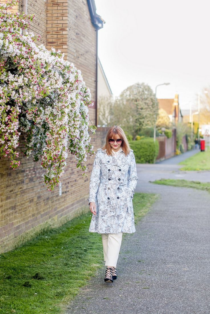 Spring fashion: Blue floral trench coat \ white trousers \ black lace-up ghillie shoes \ oversized 70s sunglasses | Not Dressed As Lamb, over 40 style