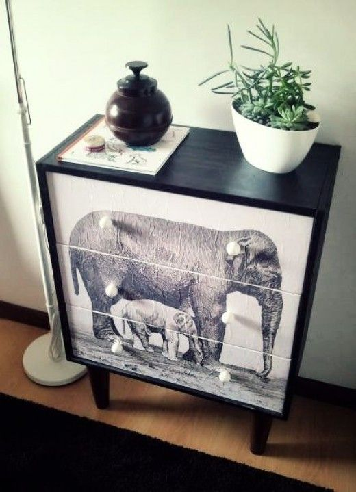 This piece of furniture started life as a plain IKEA product, but decoupaging a picture to the front has made it unique.