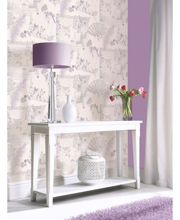 This stunning Ava wallpaper has an elegant collage theme of feminine motifs that includes flowers, fans, feathers, butterflies and birds. The pretty design features subtle metallic highlights and is in soft muted tones of heather on a pale lilac coloured background, also available in teal.