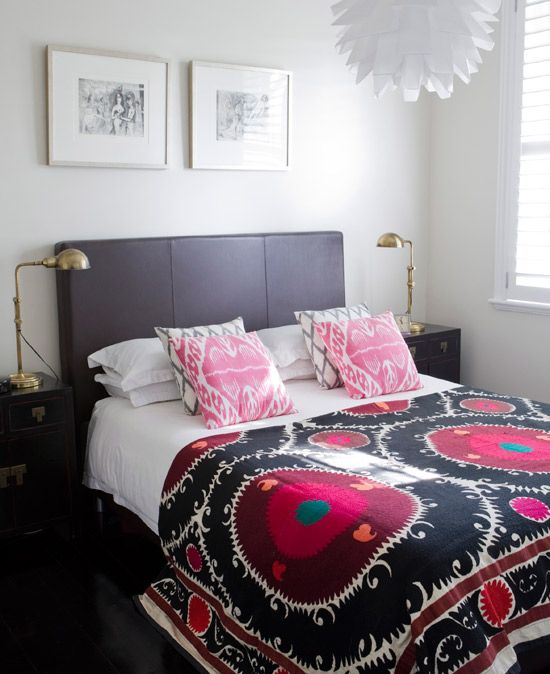 A simple bedroom is brought to life with tribal-patterned bedding. Opt for classic white bedding and introduce accessories like colourful cushions and throws that can be switched up when tastes change.