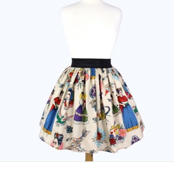 "Viva Frida Pinup Skirt New In this skirt you find a young Frida with ""Viva Frida"" around her. A flying dove and ""Todo Para Ti"" underneath, two Frida's holding hands and ""Ya No Estoy Sola"" wrapping around them. A bow with ""El Dolor, El Placer, Y La Muerte"" wrapping around it, a teary Frida and ""Si, Te Lloro"" underneath, a bouquet of flowers and ""Yo Te Esperare"" around it. A glowing red heart with thorns around it and ""Te Amo Mucho"" across it, a paint palette and ""Mi Vida"" underneath it, and…"