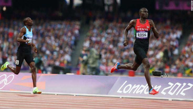 8/9/12 - David Lekuta Rudisha of Kenya approaches the finish line ahead of Nijel Amos of Botswana to win gold and set a world record in the men's 800-meter final.