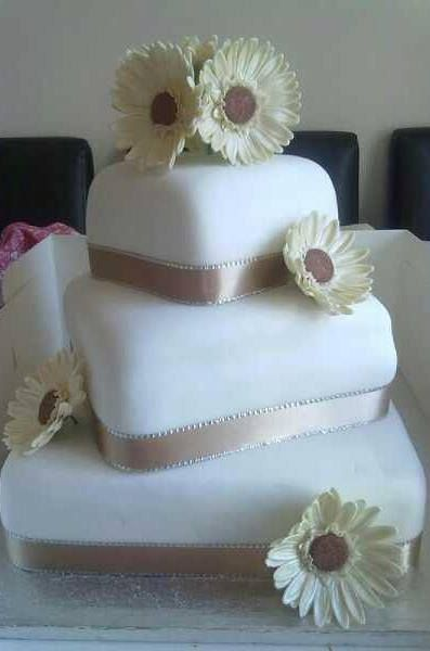 Simple Wedding Cake with Handmade Flowers decorated by Coast Cakes Ltd