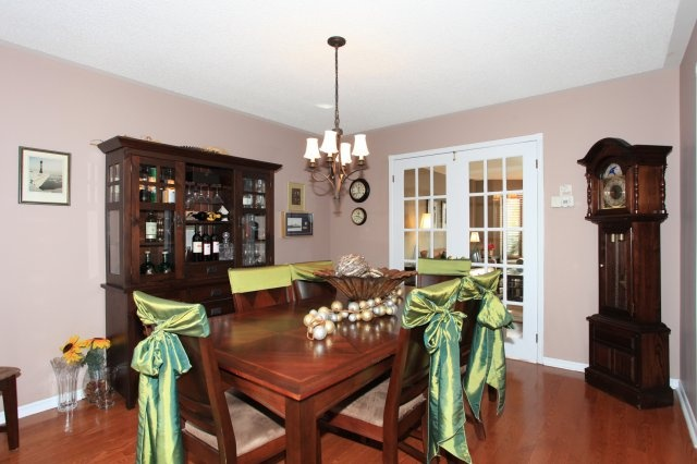 Gracious formal dining area with hardwood flooring & french doors