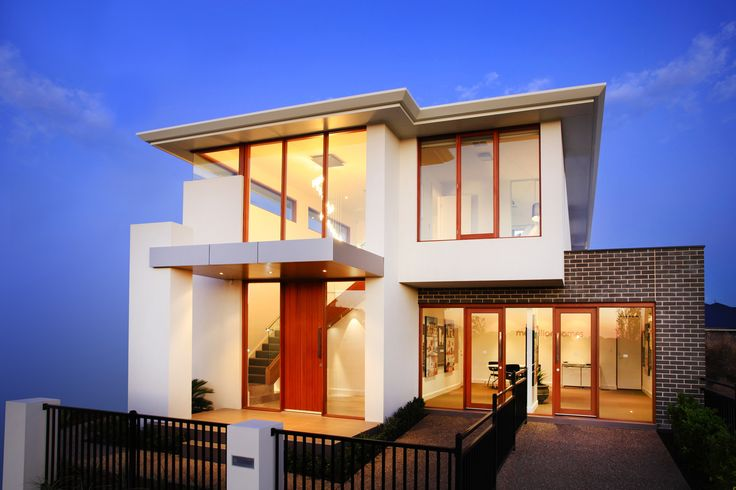 A two storey statement home with open spaces and natural light, high ceilings and floor to ceiling windows.
