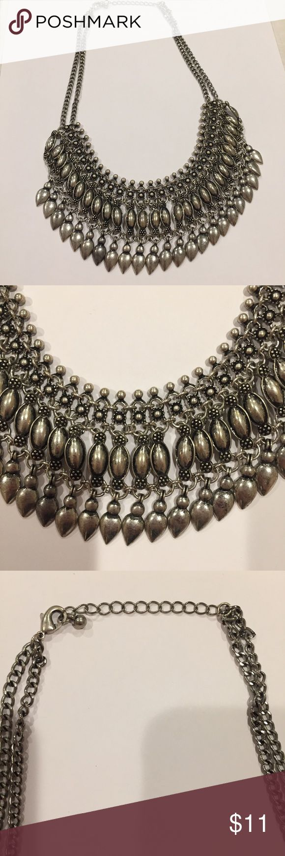 Chunky silver colored necklace Chunky silver necklace. Falls high on neck line. Comfortable and stylish. Limited wear and good condition. Jewelry Necklaces