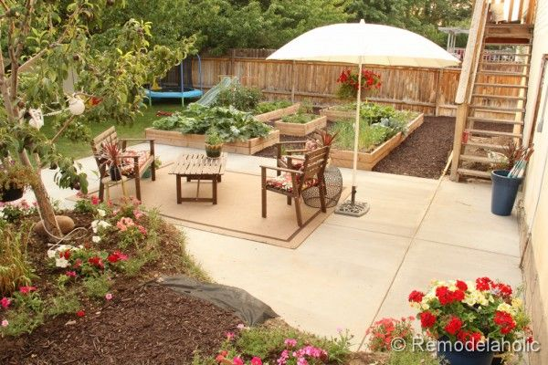 DIY Concrete Patio: Part Two  Like the idea of an outdoor rug below the patio furniture