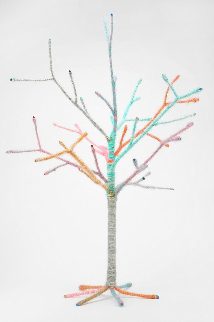 Yarn-wrapped tree from Urban Outfitters. (Pinning this in case it goes on sale after the holidays.)