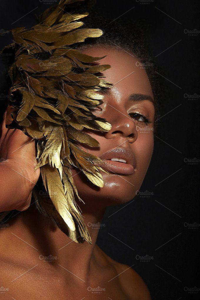 African American Stock Photos! #Beauty Golden feathers. by Ekaterina Jurkova on @creativemarket