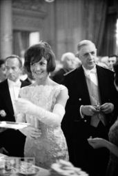 Jackie steals a champagne at the first evening event at Versailles, hosted by President de Gaulle, June 1961 European tour.