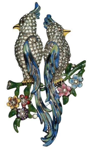 Coro Enamel Rhinestone Calopsitta Bird Duette 1941. These 2 birds are sitting on a branch back to back. Their bodies are covered in clear rhinestones. The wings, branch and flowers are enameled. The back is rhodium plated metal.