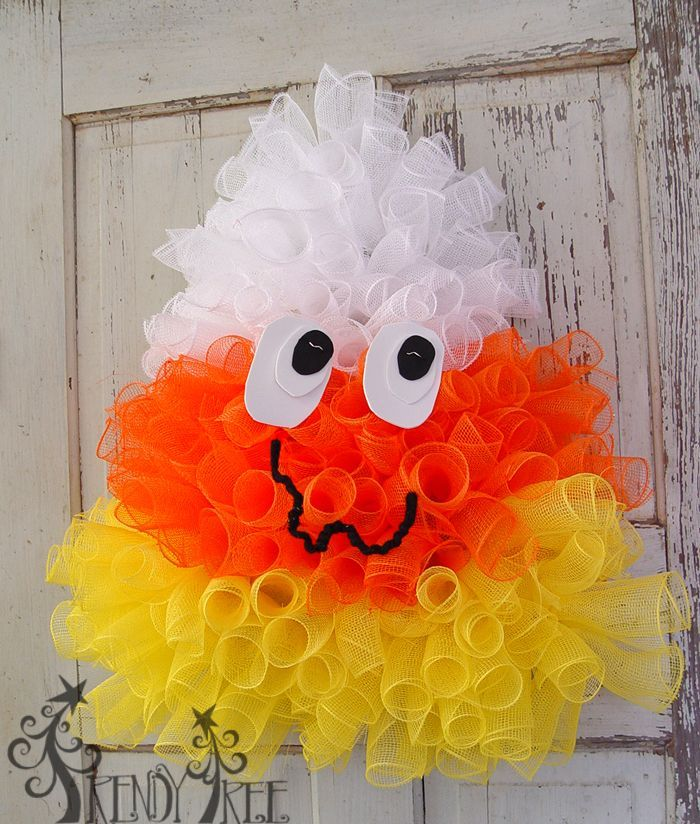 Candy Corn Wreath Tutorial - Video and written instructions, supply list.  http://www.trendytree.com/blog/candy-corn-wreath-tutorial/