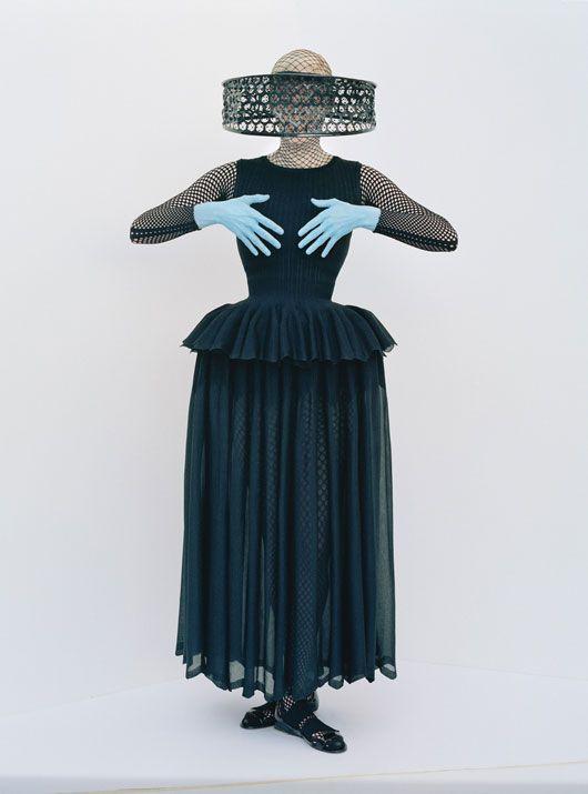 Tilda in Azzedine Alaïa top, skirt, and shoes; Emilio Cavallini bodysuit; Alexander McQueen headpiece.
